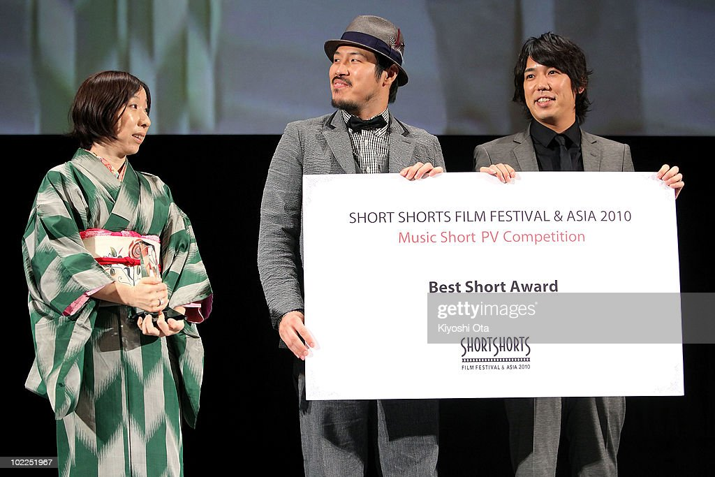 Director Yuki Iwata (L) receives the 'Music Short PV Competition Best Short Award' for her film '8mm' with Shintaro Tokita (C) and Takuya Ohashi of jazz fusion duo Sukima Switch during the Short Shorts Film Festival & Asia 2010 Award Ceremony at Jingu Kaikan on June 20, 2010 in Tokyo, Japan. The annual festival is one of the Asia's largest festivals for international short films, and the Grand Prix winner, selected from the three official Best Short Award winners, will be eligible for an Academy Award nomination in the Short Films category.