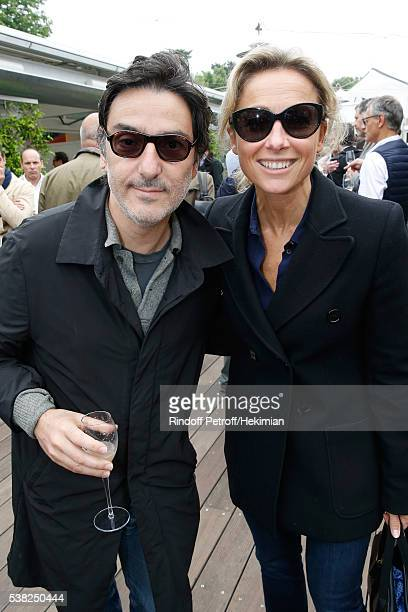 Director Yvan Attal and journalist AnneSophie Lapix attend Day Fifteen Men single's Final of the 2016 French Tennis Open at Roland Garros on June 5...
