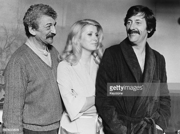 Director Yves Robert and actors Catherine Deneuve and Jean Rochefort on the set of the film 'Courage Fuyons' circa 1979