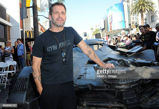 Director Zach Snyder poses with the Batmobile featured in his film 'Superman v Batman Dawn Of Justice' at Batman creator Bob Kane's Star ceremony...