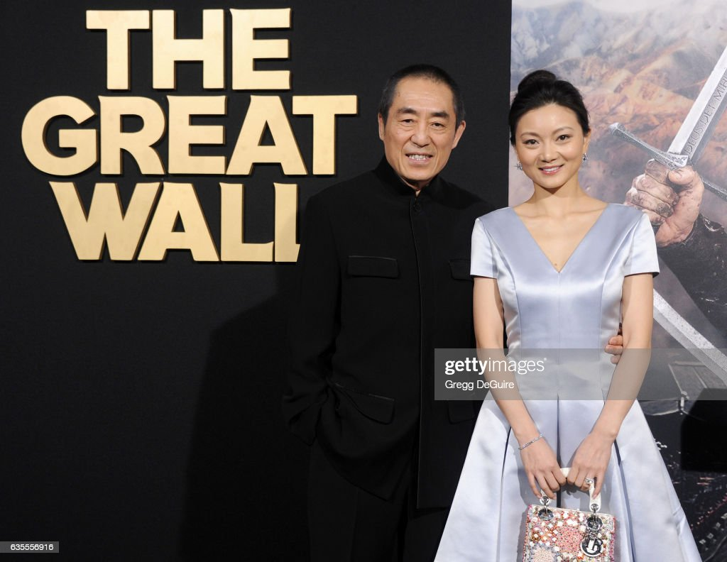 Director Zhang Yimou and wife Chen Ting arrive at the premiere of Universal Pictures' 'The Great Wall' at TCL Chinese Theatre IMAX on February 15, 2017 in Hollywood, California.