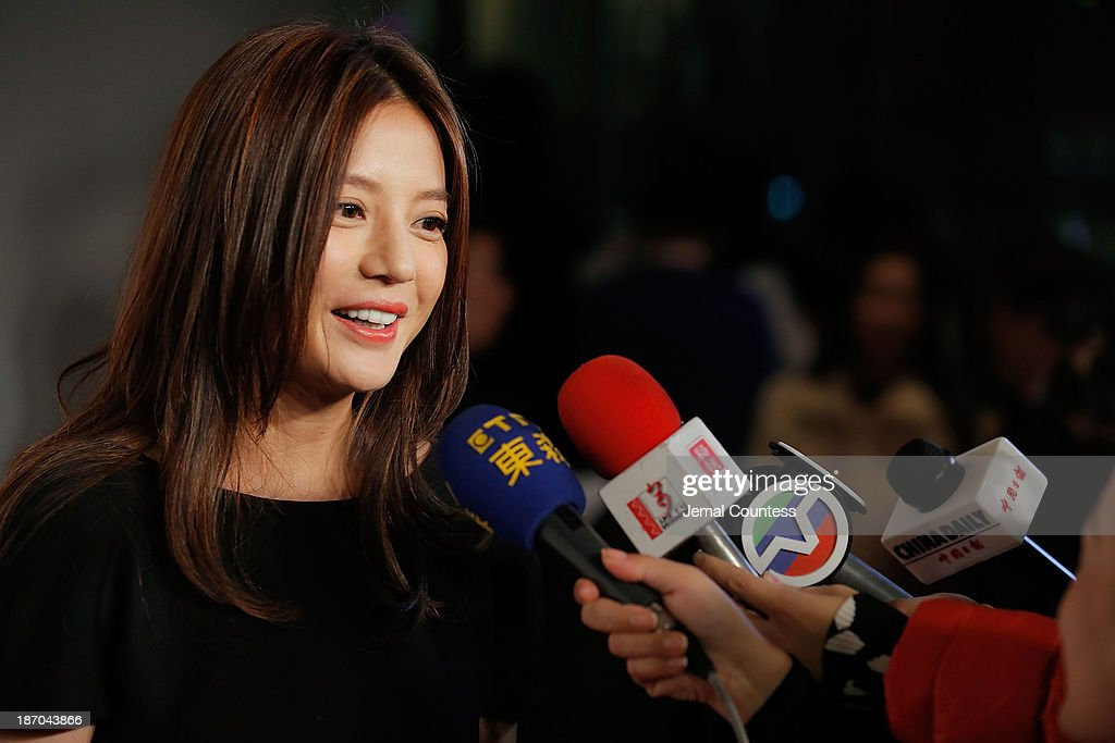 Director <a gi-track='captionPersonalityLinkClicked' href=/galleries/search?phrase=Zhao+Wei&family=editorial&specificpeople=540140 ng-click='$event.stopPropagation()'>Zhao Wei</a> speaks with the media at the 4th New York Chinese Film Festival Opening Night at Alice Tully Hall at Lincoln Center on November 5, 2013 in New York City.