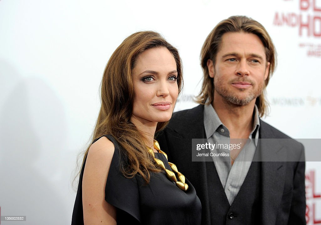 Director/actor <a gi-track='captionPersonalityLinkClicked' href=/galleries/search?phrase=Angelina+Jolie&family=editorial&specificpeople=201591 ng-click='$event.stopPropagation()'>Angelina Jolie</a> and actor <a gi-track='captionPersonalityLinkClicked' href=/galleries/search?phrase=Brad+Pitt+-+Actor&family=editorial&specificpeople=201682 ng-click='$event.stopPropagation()'>Brad Pitt</a> pose for a photo during the premiere of 'In the Land of Blood and Honey' at the School of Visual Arts on December 5, 2011 in New York City.