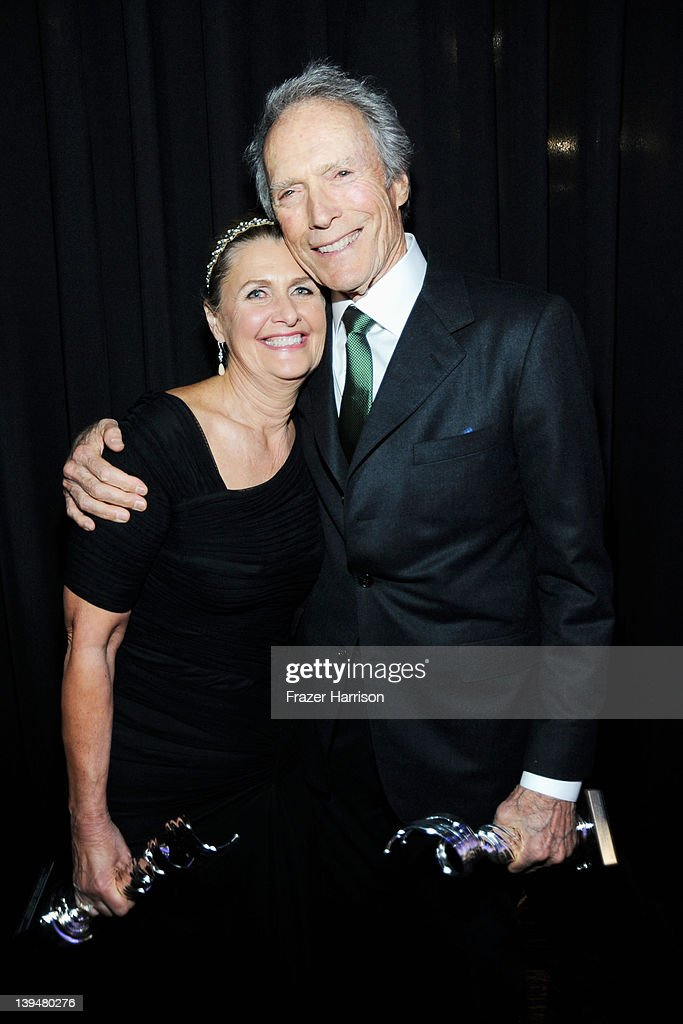 Director/actor <a gi-track='captionPersonalityLinkClicked' href=/galleries/search?phrase=Clint+Eastwood&family=editorial&specificpeople=201795 ng-click='$event.stopPropagation()'>Clint Eastwood</a> and costume designer Deborah Hopper pose with the award for Distinguished Collaborator at the 14th Annual Costume Designers Guild Awards With Presenting Sponsor Lacoste held at The Beverly Hilton hotel on February 21, 2012 in Beverly Hills, California.