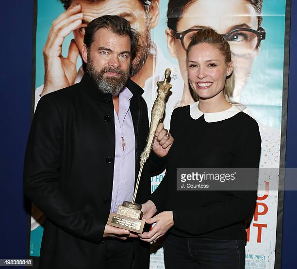 Director/actor Clovis Cornillac and cowriter/actress Lilou Fogli pose for a photo with the 2015 In French Audience Award at the 2015 In French With...