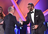 Director/actor Tyler Perry presents the Best Actor in a Comedy award to actor Michael Keaton for 'Birdman' onstage during the 20th annual Critics'...