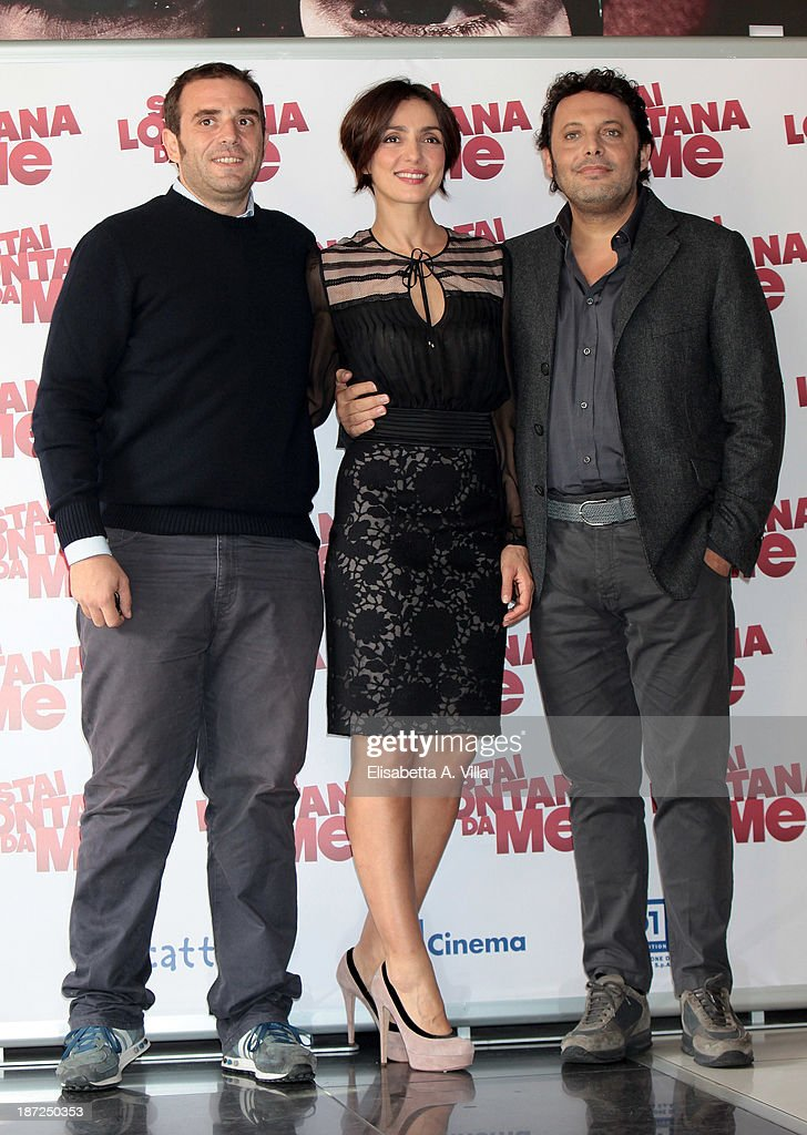 DirectorAlessio Maria Federici, actress <a gi-track='captionPersonalityLinkClicked' href=/galleries/search?phrase=Ambra+Angiolini&family=editorial&specificpeople=4333551 ng-click='$event.stopPropagation()'>Ambra Angiolini</a> and actor <a gi-track='captionPersonalityLinkClicked' href=/galleries/search?phrase=Enrico+Brignano&family=editorial&specificpeople=676896 ng-click='$event.stopPropagation()'>Enrico Brignano</a> attend 'Stai Lontana Da me' photocall at Cinema Adriano on November 7, 2013 in Rome, Italy.