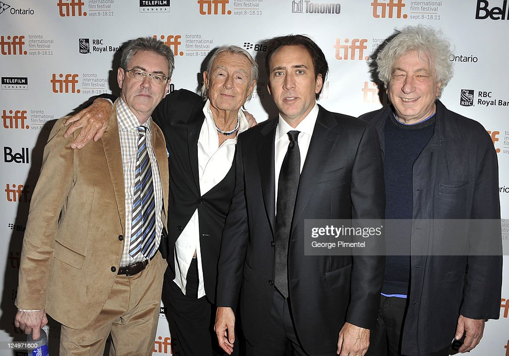 Director/CEO of TIFF Piers Handling director Joel Schumacher actor Nicolas Cage and executive producer Avi Lerner arrive at 'Trespass' Premiere at...