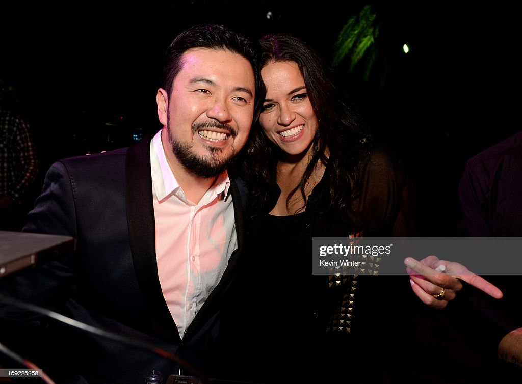 Director/executive producer Justin Lin (L) and actress Michelle Rodriguez pose at the after party for the premiere of Universal Pictures' 'Fast & Furious 6' at the Gibson Amphitheatre on May 21, 2013 in Universal City, California.