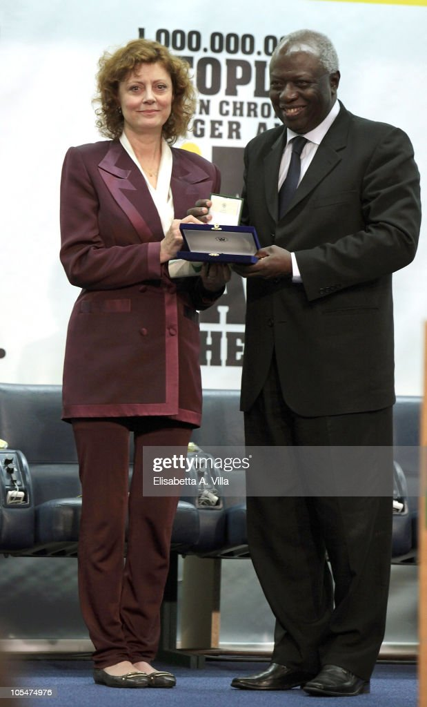 Director-General <a gi-track='captionPersonalityLinkClicked' href=/galleries/search?phrase=Jacques+Diouf&family=editorial&specificpeople=632850 ng-click='$event.stopPropagation()'>Jacques Diouf</a> (R) poses with U.S. actress <a gi-track='captionPersonalityLinkClicked' href=/galleries/search?phrase=Susan+Sarandon&family=editorial&specificpeople=202474 ng-click='$event.stopPropagation()'>Susan Sarandon</a> during the World Food Day 2010 Ceremony at FAO headquarter on October 15, 2010 in Rome, Italy. <a gi-track='captionPersonalityLinkClicked' href=/galleries/search?phrase=Susan+Sarandon&family=editorial&specificpeople=202474 ng-click='$event.stopPropagation()'>Susan Sarandon</a> is being appointed today as FAO's Goodwill Ambassador to help in the global fight against hunger.
