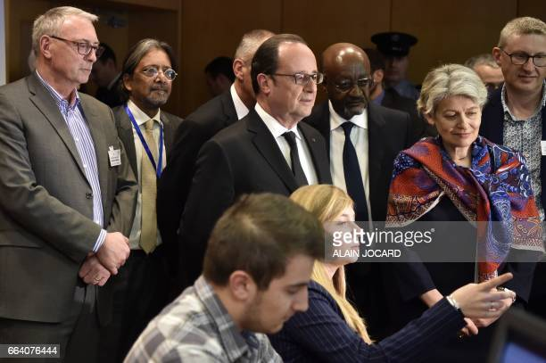 DirectorGeneral of the United Nations Educational Scientific and Cultural Organisation Irina Bokova and French President Francois Hollande meet youth...