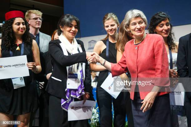 DirectorGeneral of UNESCO Irina Bokova and members of #Unite4Heritage movemenduring 41st Session of the World Heritage Committee in Krakow Poland on...