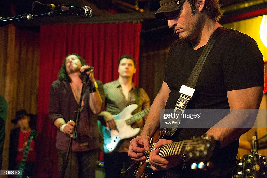 Director/musician Robert Rodriguez performs on stage with his band Chingon during the 'Sin City: A Dame to Kill For' premiere after party at The Rattle Inn on August 20, 2014 in Austin, Texas.