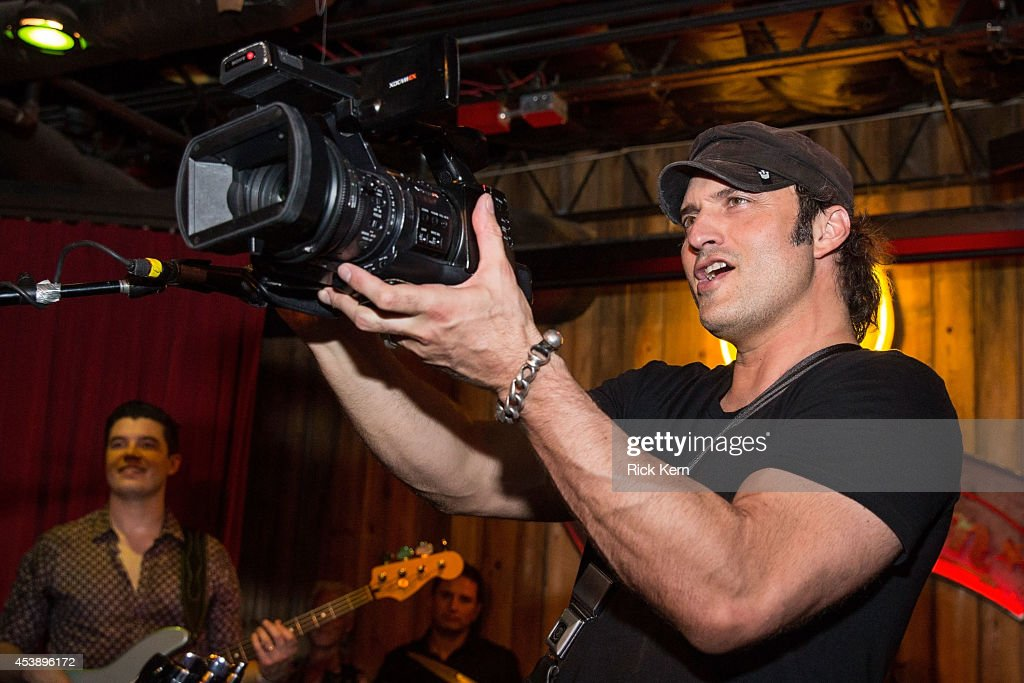 Director/musician Robert Rodriguez video tapes the crowd during the 'Sin City: A Dame to Kill For' premiere after party at The Rattle Inn on August 20, 2014 in Austin, Texas.