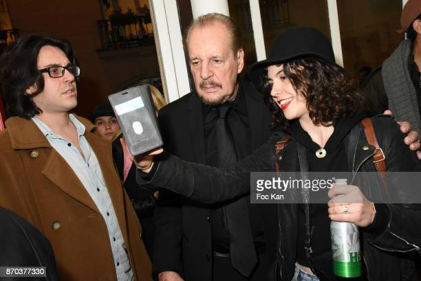 Director/painter Larry Clark poses for selfies and photos with his fans during the Larry Clark and Jonathan Velasquez Photo Exhibition as part of...