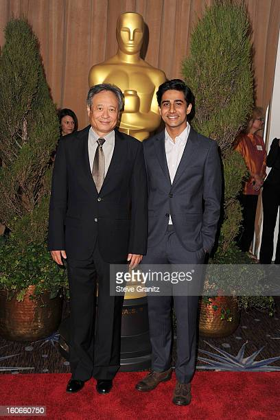 Director/producer Ang Lee and actor Suraj Sharma attend the 85th Academy Awards Nominees Luncheon at The Beverly Hilton Hotel on February 4 2013 in...