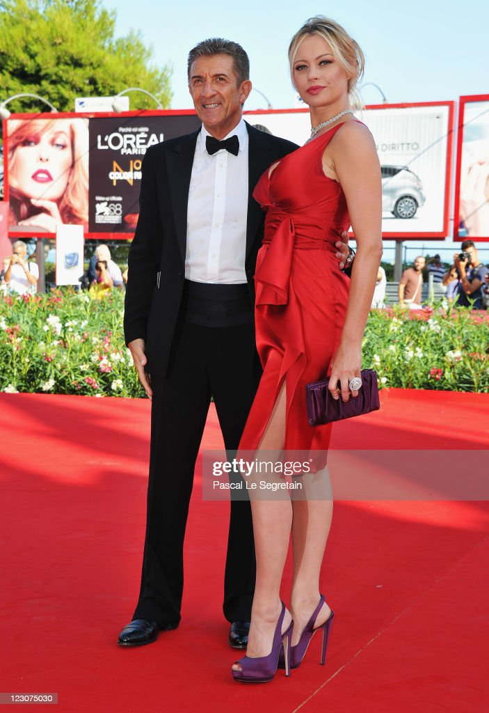 Director/producer Ezio Greggio and actress Anna Falchi attend the 'Box Office 3D' premiere during the 68th Venice Film Festival at Palazzo del Cinema...