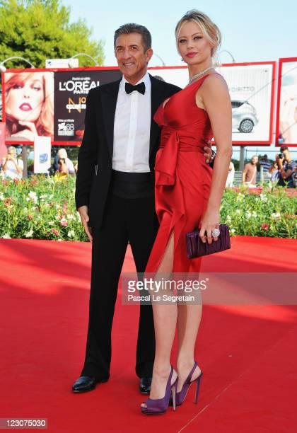Director/producer Ezio Greggio and actress Anna Falchi attend the 'Box Office 3D' premiere during the 68th Venice Film Festival at Palazzo del Cinema...