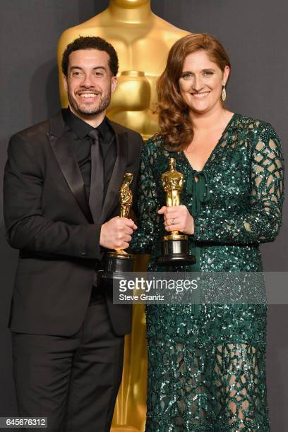 Director/producer Ezra Edelman and producer Caroline Waterlow winners of the award for Documentary for 'OJ Made in America' pose in the press room...