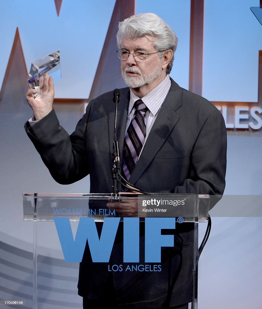 Director/producer <a gi-track='captionPersonalityLinkClicked' href=/galleries/search?phrase=George+Lucas&family=editorial&specificpeople=202500 ng-click='$event.stopPropagation()'>George Lucas</a> accepts the Norma Zarky Humanitarian Award onstage during Women In Film's 2013 Crystal + Lucy Awards at The Beverly Hilton Hotel on June 12, 2013 in Beverly Hills, California.