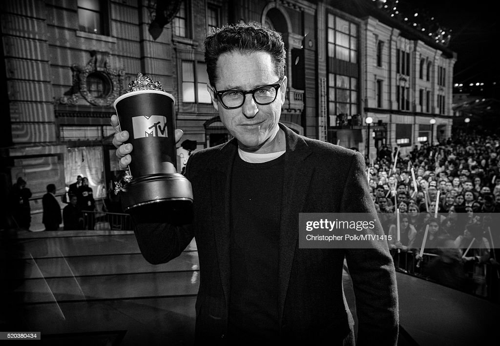 Image has been converted to black and white.) Director/producer J.J. Abrams accepts the award for Movie of the Year for 'Star Wars: The Force Awakens' onstage during the 2016 MTV Movie Awards at Warner Bros. Studios on April 9, 2016 in Burbank, California. MTV Movie Awards airs April 10, 2016 at 8pm ET/PT.