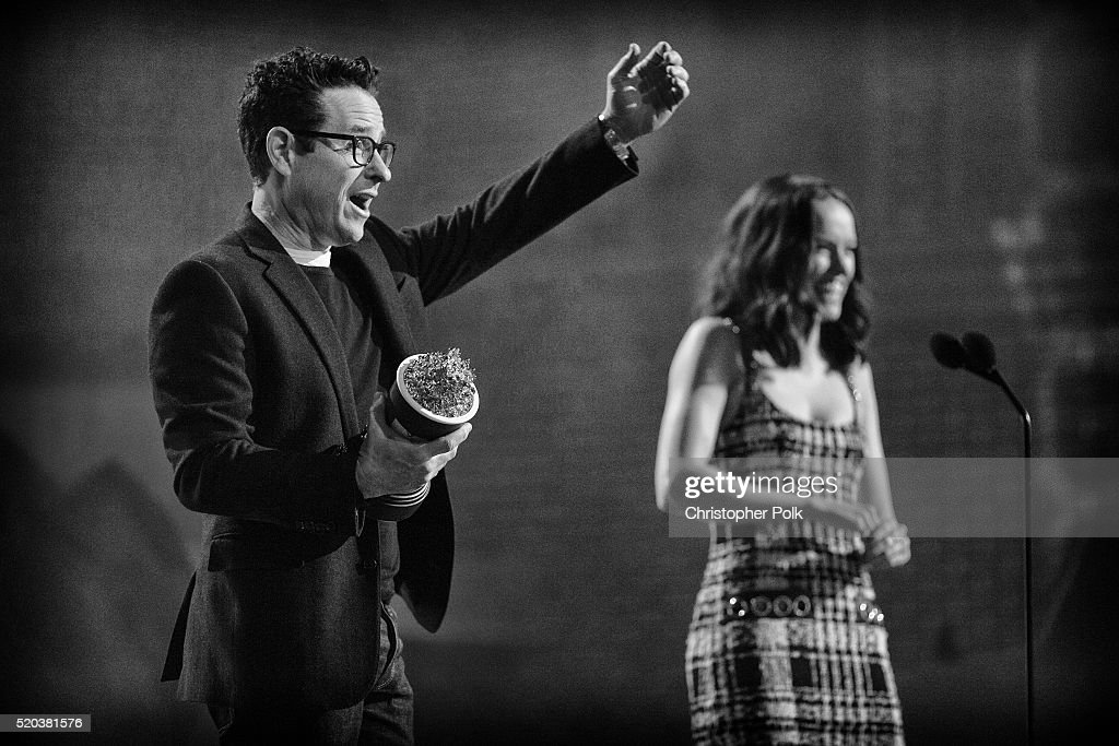Director/producer J.J. Abrams (L) and actress Daisy Ridley accept the award for Movie of the Year for 'Star Wars: The Force Awakens' onstage during the 2016 MTV Movie Awards at Warner Bros. Studios on April 9, 2016 in Burbank, California. MTV Movie Awards airs April 10, 2016 at 8pm ET/PT.