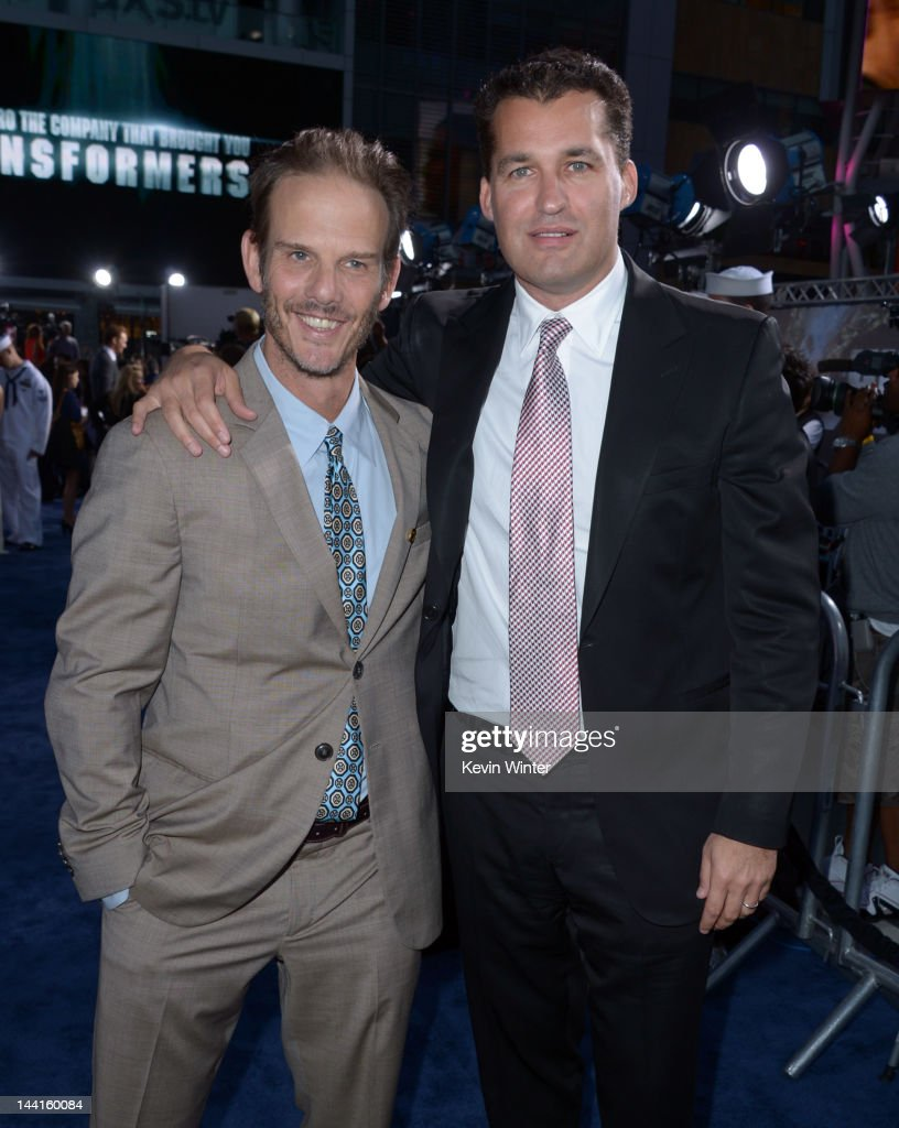 Director/producer <a gi-track='captionPersonalityLinkClicked' href=/galleries/search?phrase=Peter+Berg&family=editorial&specificpeople=221450 ng-click='$event.stopPropagation()'>Peter Berg</a> (L) and producer <a gi-track='captionPersonalityLinkClicked' href=/galleries/search?phrase=Scott+Stuber&family=editorial&specificpeople=240333 ng-click='$event.stopPropagation()'>Scott Stuber</a> arrive at the premiere of Universal Pictures' 'Battleship' at Nokia Theatre L.A. Live on May 10, 2012 in Los Angeles, California.