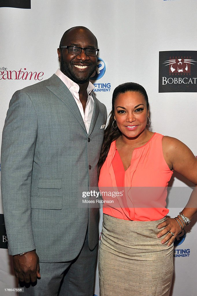 Director/Producer Roger Bobb and V103 radio personality Egypt Sherrod attend the premiere of 'In the Meantime' at the Woodruff Arts Center on August 14, 2013 in Atlanta, Georgia.
