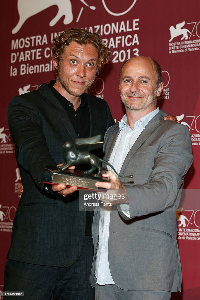 Directors Amiel Courtin-Wilson and Michael Cody pose with the Special Orizzonti Prize they received for their film 'Ruin' as they attend the Award Winners Photocall during the 70th Venice International Film Festival at Palazzo del Casino on September 7, 2013 in Venice, Italy.