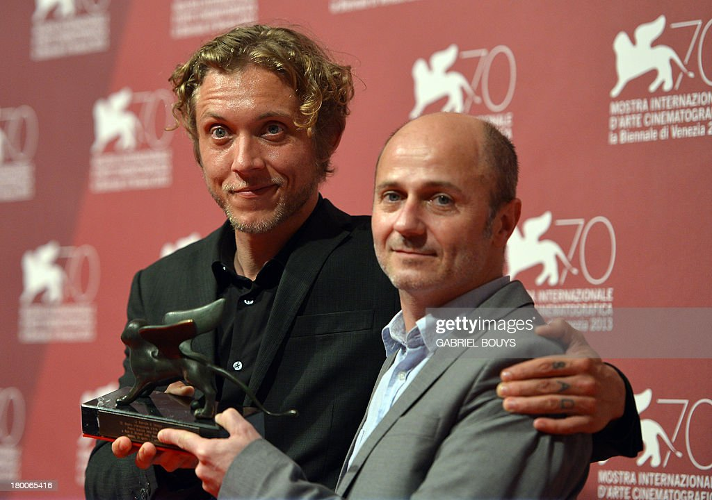 Directors Amiel Courtin-Wilson and Michael Cody pose with the Special Orizzonti Prize they received for their film 'Ruin' during a photocall after the award ceremony of the 70th Venice Film Festival on September 7, 2013 at Venice Lido.