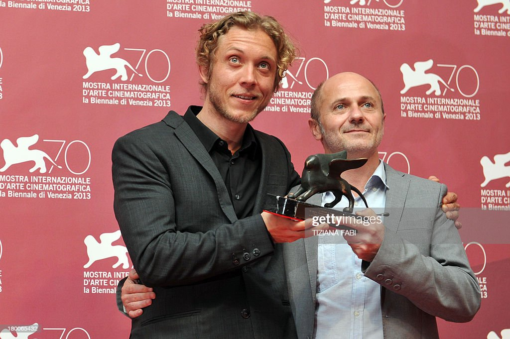 Directors Amiel Courtin-Wilson and Michael Cody pose with the Special Orizzonti Prize they received for their film 'Ruin' during a photocall after the award ceremony of the 70th Venice Film Festival on September 7, 2013 at Venice Lido. AFP PHOTO / TIZIANA FABI