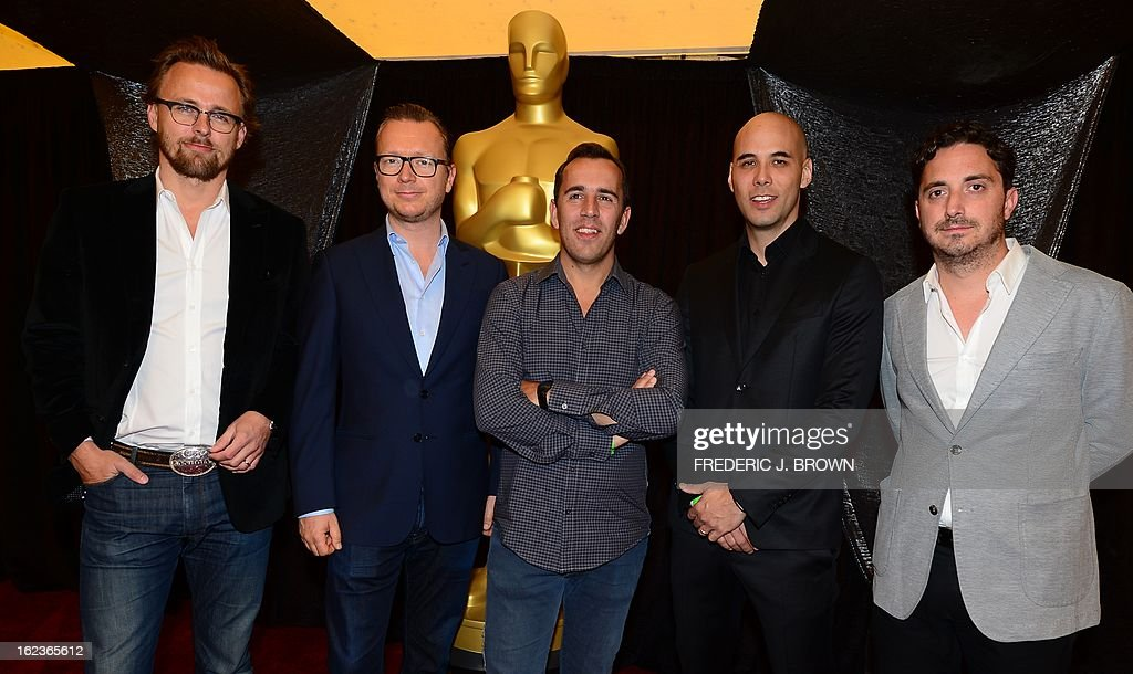 Directors and producers of the best Foreign Film nominations for the 85th Academy Awards, also known as The Oscar's, pose for the media in Hollywood on February 22, 2013 in California, ahead of the awards whic take place on Sunday, February 24. Espen Sandberg (L) and Joachim Roenning (2L) from the Norwegian film 'Kon-Tiki' ; Nicolaj Arcel (C) from the Danish film 'A Royal Affair' ; Kim Nguyen (2R) from the Canadian film 'War Witch' and Pablo Larrain (R) from the the Chilean film 'No'.' AFP PHOTO / Frederic J. BROWN