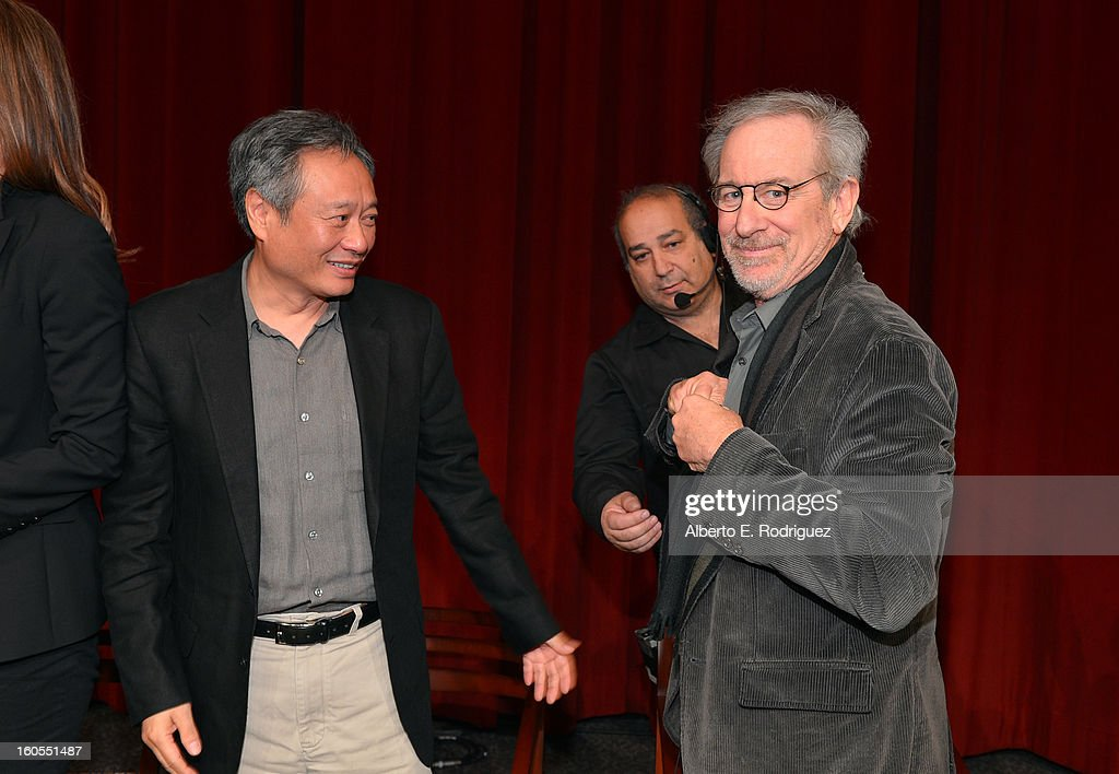Directors <a gi-track='captionPersonalityLinkClicked' href=/galleries/search?phrase=Ang+Lee&family=editorial&specificpeople=215104 ng-click='$event.stopPropagation()'>Ang Lee</a> and <a gi-track='captionPersonalityLinkClicked' href=/galleries/search?phrase=Steven+Spielberg&family=editorial&specificpeople=202022 ng-click='$event.stopPropagation()'>Steven Spielberg</a> prepare to leave the stage after the 65th Annual Directors Guild of America Awards Feature Film Symposium held at the DGA on February 2, 2013 in Los Angeles, California.