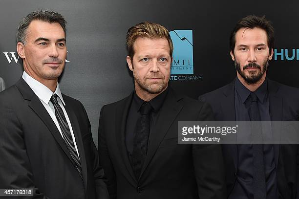 Directors Chad Stahelski and David Leitch and actor Keanu Reeves attend the 'John Wick' New York Premiere at Regal Union Square Theatre Stadium 14 on...