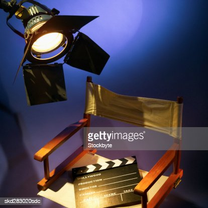Director's chair and clapperboard and spotlight : Stock Photo