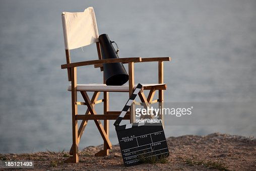 Director's chair in outdoor with megaphone and film slate.