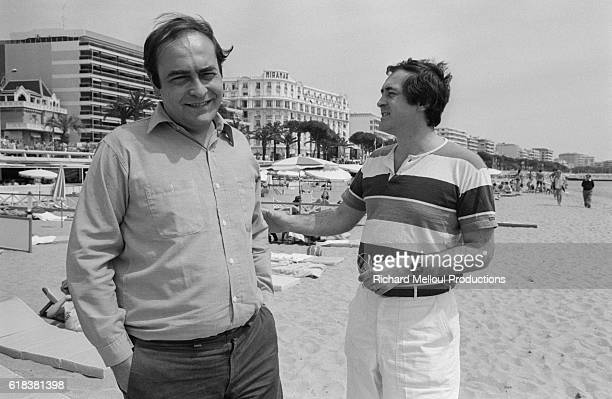 Directors Giuseppe Bertolucci and Bernardo Bertolucci walk on the beach in Cannes France The two are attending the 1980 Cannes Film Festival where...