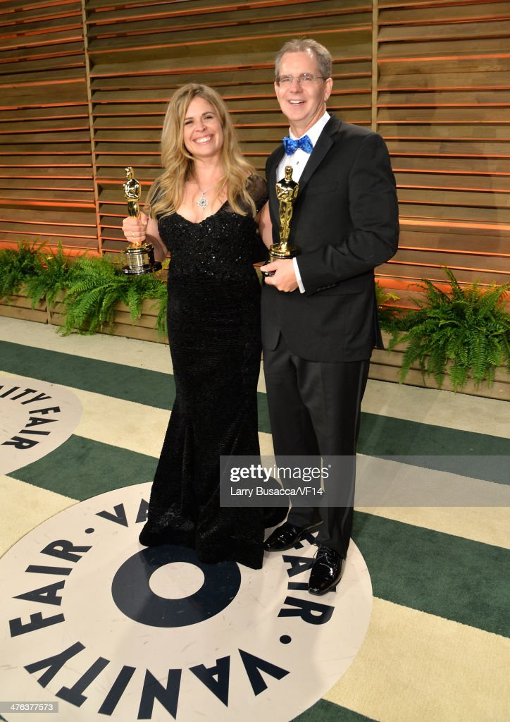 Directors Jennifer Lee and Chris Buck attend the 2014 Vanity Fair Oscar Party Hosted By Graydon Carter on March 2 2014 in West Hollywood California