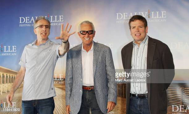 US directors Jerry Zucker Jim Abrahams and David Zucker pose during the photocall for their tribute during the 35th Deauville Film Festival on...