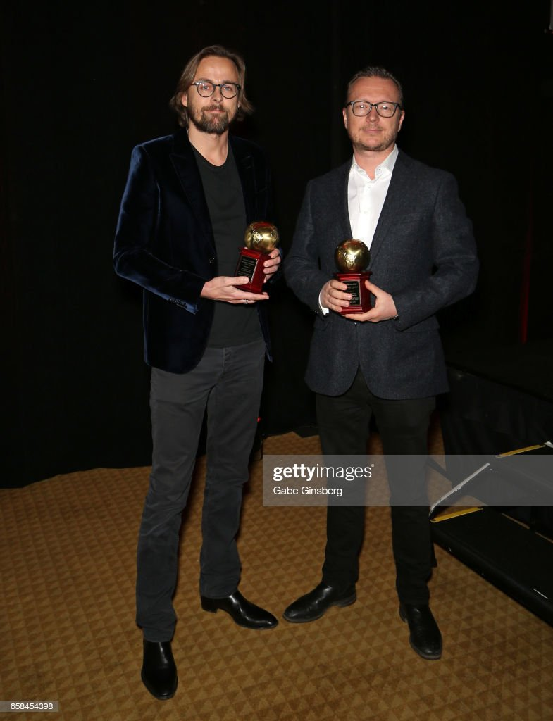 Directors Joachim Ronning (L) and Espen Sandberg, recipients of the International Filmmakers of the Year award for the movie 'Pirates of the Caribbean: Dead Men Tell No Tales,' attend the International Day Lunch durng CinemaCon at Caesars Palace on March 27, 2017 in Las Vegas, United States.