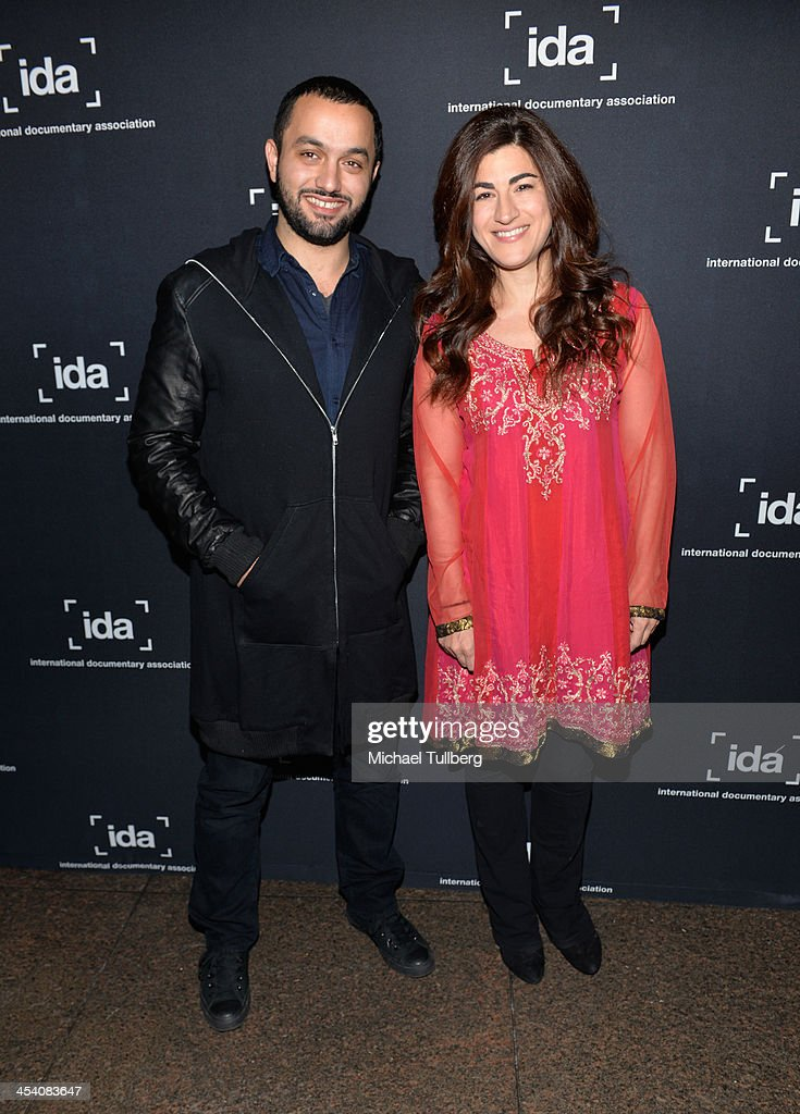 Directors Karim Amer and Jehane Noujaim attends the International Documentary Association's 2013 IDA Documentary Awards at Directors Guild Of America on December 6, 2013 in Los Angeles, California.