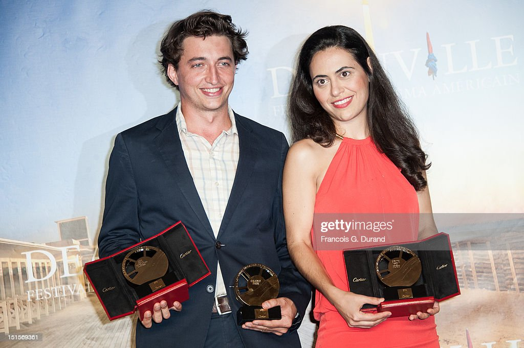 Directors Lucy Mulloy and Benh Zeitlin pose with their trophies after at the closing ceremony of the 38th Deauville American Film Festival on September 8, 2012 in Deauville, France.