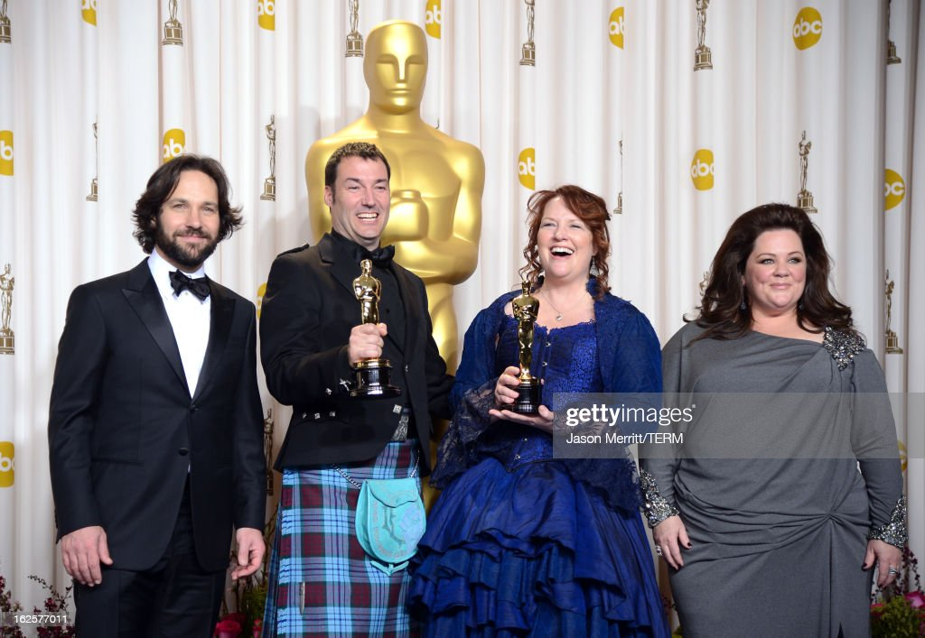 Directors Mark Andrews (2nd L) and Brenda Chapman (2nd R), winners of the Best Animated Feature award for 'Brave,' with presenters Paul Rudd (L) and Melissa McCarthy (R), pose in the press room during the Oscars held at Loews Hollywood Hotel on February 24, 2013 in Hollywood, California.