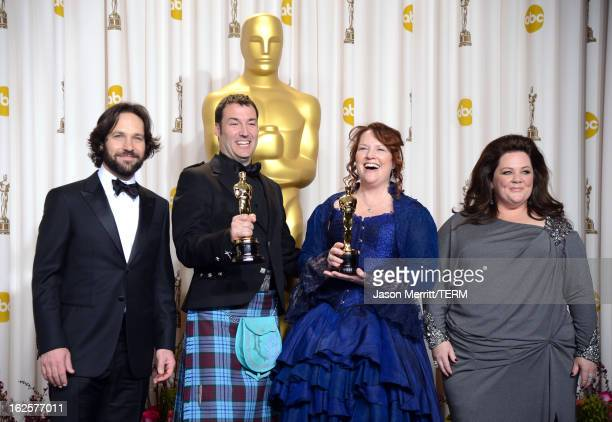 Directors Mark Andrews and Brenda Chapman winners of the Best Animated Feature award for 'Brave' with presenters Paul Rudd and Melissa McCarthy pose...