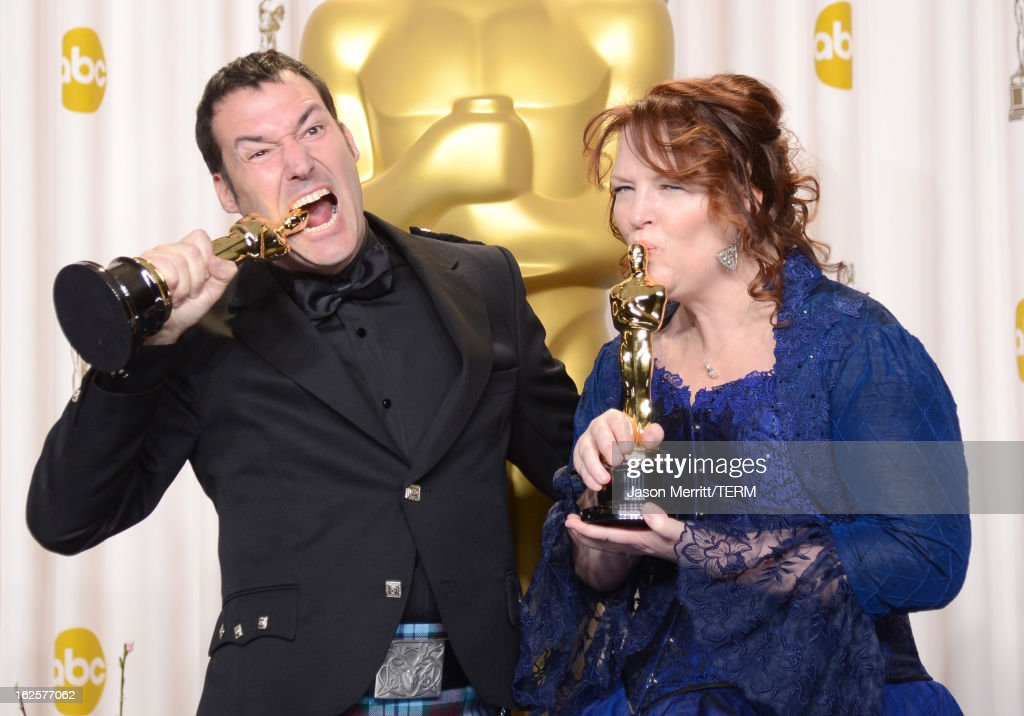 Directors Mark Andrews and <a gi-track='captionPersonalityLinkClicked' href=/galleries/search?phrase=Brenda+Chapman&family=editorial&specificpeople=5707596 ng-click='$event.stopPropagation()'>Brenda Chapman</a>, winners of the Best Animated Feature award for 'Brave,' pose in the press room during the Oscars held at Loews Hollywood Hotel on February 24, 2013 in Hollywood, California.