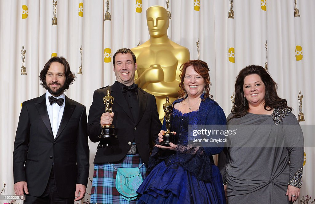 Directors Mark Andrews (2nd L) and Brenda Chapman (2nd R), winners of the Best Animated Feature award for 'Brave,' with presenters Paul Rudd (L) and Melissa McCarthy (R) in the press room during the 85th Annual Academy Awards at Loews Hollywood Hotel on February 24, 2013 in Hollywood, California.