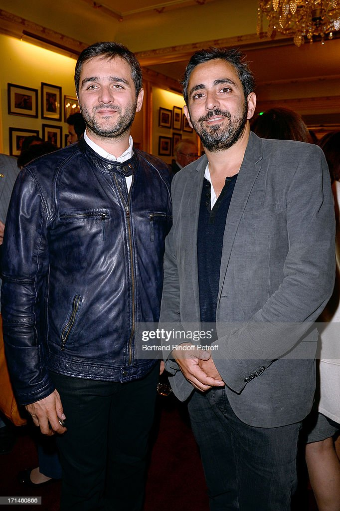 Directors of movie 'Intouchables) Eric Toledano and Olivier Nakache attend the Ary Abittan performance at Theater Edouard VII benefiting 'Un Coeur Pour La Paix' on June 24, 2013 in Paris, France.