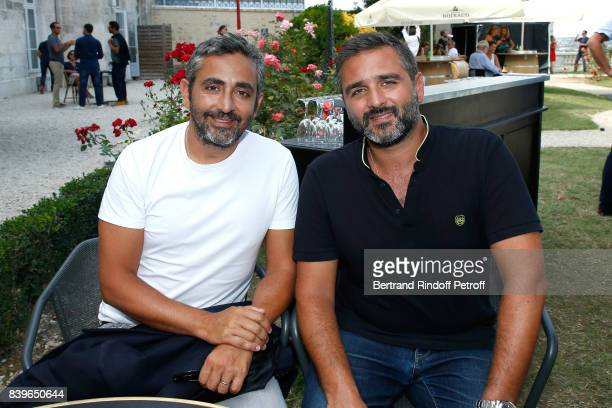 Directors of the movie 'Le sens de la fete' Eric Toledano and Olivier Nakache attend the 10th Angouleme FrenchSpeaking Film Festival Day Five on...