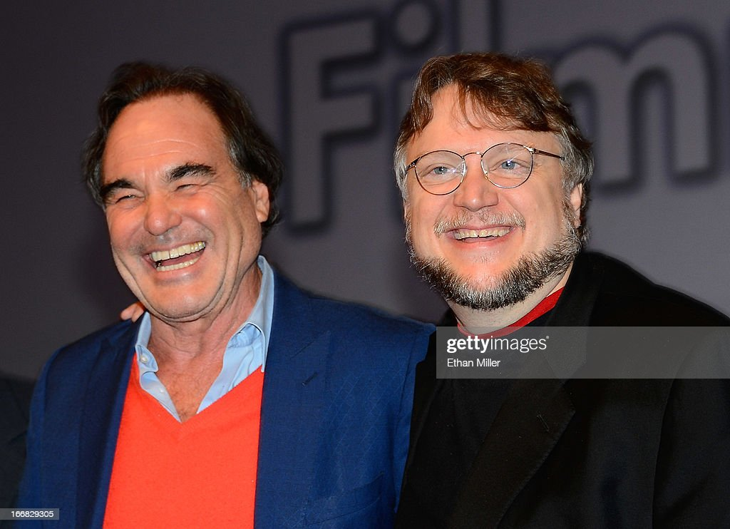 Directors <a gi-track='captionPersonalityLinkClicked' href=/galleries/search?phrase=Oliver+Stone&family=editorial&specificpeople=173458 ng-click='$event.stopPropagation()'>Oliver Stone</a> (L) and <a gi-track='captionPersonalityLinkClicked' href=/galleries/search?phrase=Guillermo+del+Toro&family=editorial&specificpeople=609181 ng-click='$event.stopPropagation()'>Guillermo del Toro</a> pose after speaking at a filmmakers' roundtable at Caesars Palace during CinemaCon, the official convention of the National Association of Theatre Owners, on April 17, 2013 in Las Vegas, Nevada.