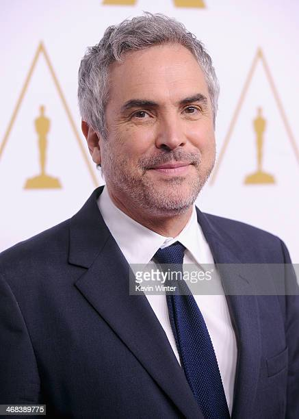 Director/writer Alfonso Cuarón attends the 86th Academy Awards nominees luncheon at The Beverly Hilton Hotel on February 10 2014 in Beverly Hills...